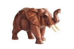 Carved wood elephant figure. Isolated royalty free stock photo