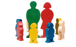 Carved wood figures. Colorful carved wooden figurines depicting a man, woman and children Royalty Free Stock Images