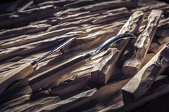 Carved wood and gouges. Detail of carved wood and gouges royalty free stock photos