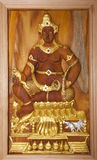 Carved wood image of lord krishna Stock Photo