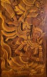 Carved wood in Thai literature, beautiful brown wood royalty free stock images