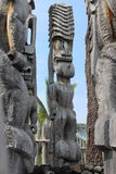 Carved Wood Tiki Statues in Hawaii Stock Images