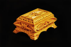 Carved wooden box handmade on a black background Royalty Free Stock Photos