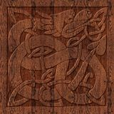 Carved wooden celtic symbol. A celtic symbol carved in oak wood. A two-toned artwork that is suitable for invitations and announcements or as a panel Stock Photography