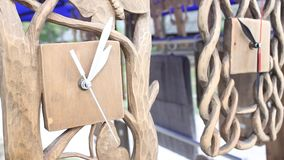Carved wooden clocks Stock Photos