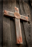 Carved Wooden Cross. With red paint at the hands and feet positions stock image