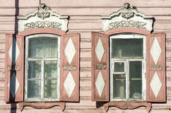 Carved wooden decorative lace decoration windows. Old wooden house. Royalty Free Stock Photography