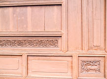 The carved wooden deer wall Stock Photos