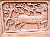 The carved wooden deer Royalty Free Stock Photography