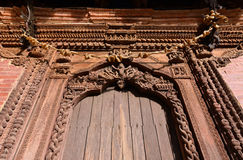 Carved wooden details on a Nepalese temple door Stock Photo