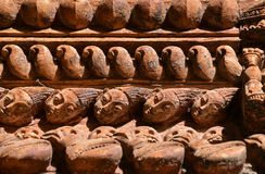 Carved wooden details on a Nepalese temple door Stock Image