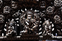 Carved wooden details on a public Hindu temple. Kathmandu, Nepal Stock Photography