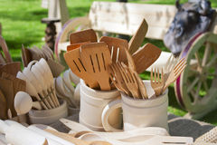 Carved wooden dishware closeup Royalty Free Stock Images