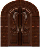 Carved wooden door. Beautiful brown carved door in the old Gothic Royalty Free Stock Photography