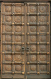 Carved wooden door. Closed, old carved wooden door Royalty Free Stock Photos