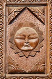 Carved wooden door fragment with sun symbol Stock Photography