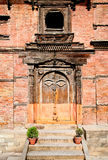 Carved wooden door on Hanuman Dhoka, old Royal Palace in Kathman Royalty Free Stock Image