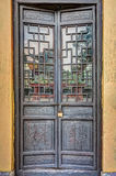 Carved wooden door with rusty old lock Stock Photography