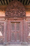 Carved wooden door at temple in Bhaktapur Royalty Free Stock Photo