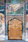 The carved wooden door in a temple Troyan Monastery in Bulgaria Royalty Free Stock Images