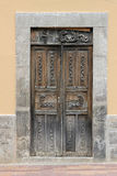 Carved Wooden Door in a Wall Stock Photo