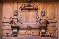 Carved wooden doorway Stock Photos