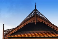 Carved wooden eaves Clay roof of ancient Thai style. Royalty Free Stock Images