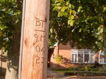 Carved wooden electrical post outside lettering numbering Royalty Free Stock Photos