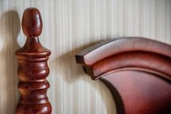 Carved wooden elements of a headboard Stock Photos