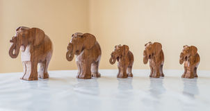 Carved wooden elephants on table. Carved wooden elephants on white table in the room Royalty Free Stock Photos