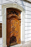 Carved wooden entrance door Royalty Free Stock Image