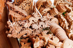 Carved wooden figures of dragons and other symbols of luck Royalty Free Stock Photos