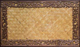 Carved wooden frame and Bamboo wood Stock Image