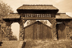 Carved Wooden Gate. Traditional carved wooden gate from Maramures region, Romania, sepia tones royalty free stock images