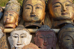 Carved wooden heads of Buddha Royalty Free Stock Photo