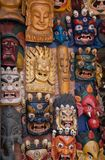 Carved wooden Hindu masks on outdoor wall Royalty Free Stock Photo