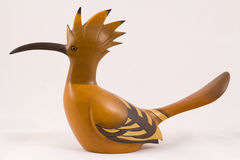 Carved Wooden Hoopoe. A carved wooden hoopoe on a plain back ground Royalty Free Stock Images