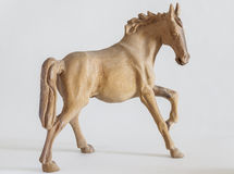 Carved wooden horse. On white background Stock Photos