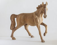 Carved wooden horse. On white background Royalty Free Stock Images