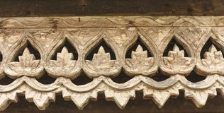 Carved wooden lattice work with Thai style pattern art. Stock Photo