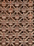 Carved Wooden Latticework. With flowers and squares design creating a perforated wall Stock Photography