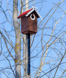 Carved wooden nest box handmade with red tile roof Stock Photo