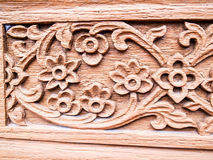 The carved wooden old flower Royalty Free Stock Photo
