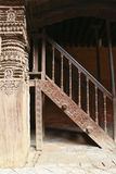 Carved wooden pillar and stairs in Nepal Stock Photo