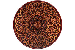 Carved wooden plate. Royalty Free Stock Photo