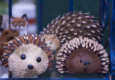 Carved wooden porcupines Royalty Free Stock Images