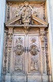 Carved wooden portal. Of an italian church Stock Image