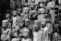 The carved. Wooden puppets black and white royalty free stock photo