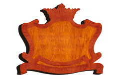 Carved wooden sign in shape of crown Stock Photos