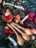Carved wooden spoon in wood, woodwork, colors of autumn. Carving Wood Spoons Spoon Mushrooms Fungi Cones Birch Nuts Autumn Berries Leaves Colors Woodwork stock photos